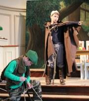 Robin Hood bows the knee to King Richard.